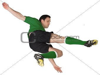 Football player in green kicking