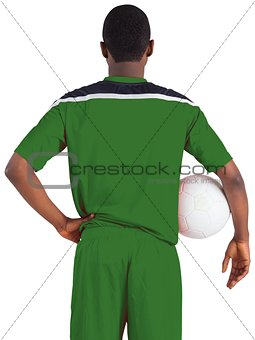 Football player in green holding ball