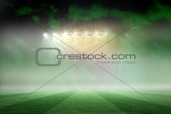 Football pitch under green sky and spotlights