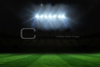 Football pitch under spotlights
