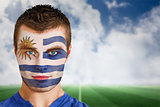 Uruguay football fan in face paint