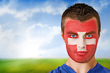 Swiss football fan in face paint