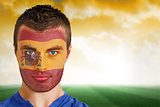 Spain football fan in face paint