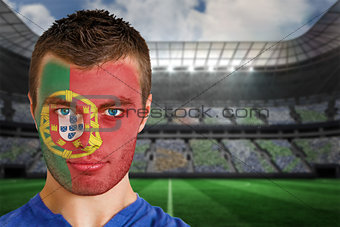 Portugal football fan in face paint