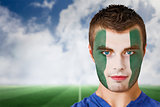Nigeria football fan in face paint
