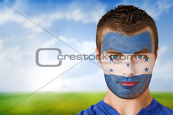 Honduras football fan in face paint