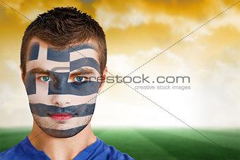 Greek football fan in face paint