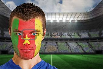 Cameroon football fan in face paint