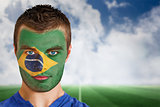 Brazil football fan in face paint