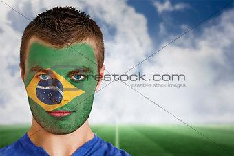 Brazil football fan in face paint
