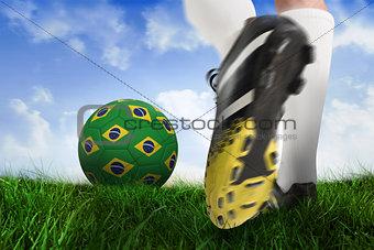 Football boot kicking brasil ball