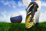 Football boot kicking russia ball