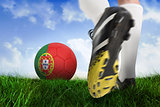 Football boot kicking portugal ball