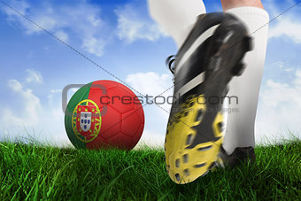 Football boot kicking portugal ball
