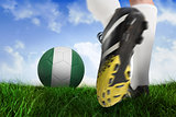Football boot kicking nigeria ball