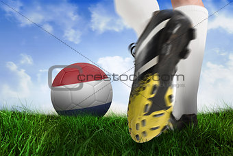 Football boot kicking netherlands ball