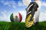 Football boot kicking mexico ball