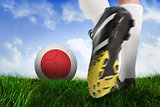 Football boot kicking japan ball
