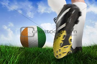 Football boot kicking ivory coast ball