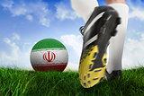 Football boot kicking iran ball