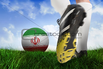 Football boot kicking iran ball