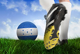 Football boot kicking honduras ball