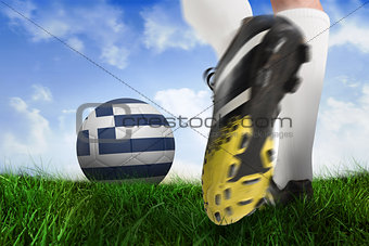 Football boot kicking greece ball