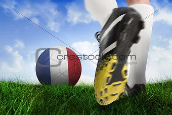 Football boot kicking france ball