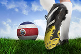 Football boot kicking costa rica ball