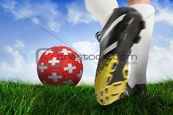 Football boot kicking switzerland ball