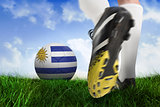Football boot kicking uruguay ball