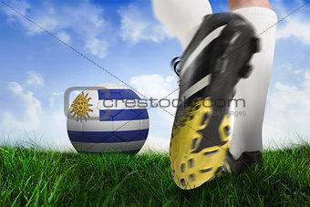 Football boot kicking uruguay ball