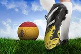 Football boot kicking spain ball