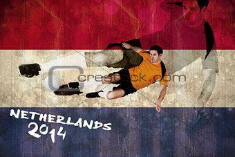 Football player in orange kicking
