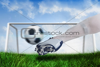 Close up of football player kicking ball