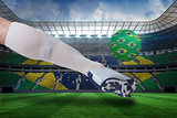 Close up of football player kicking brasil ball