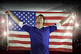 American soccer fan holding flag