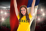Pretty football fan in brasil t-shirt holding chile flag