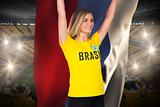 Excited football fan in brasil tshirt holding russia flag