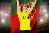 Excited football fan in brasil tshirt holding portugal flag
