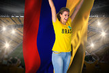 Excited football fan in brasil tshirt holding colombia flag