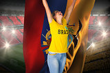 Excited football fan in brasil tshirt holding ecuador flag