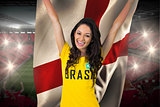 Excited football fan in brasil tshirt holding england flag