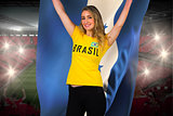 Excited football fan in brasil tshirt holding honduras flag