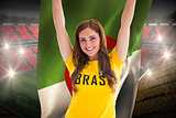 Pretty football fan in brasil t-shirt holding algeria flag