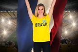 Excited football fan in brasil tshirt holding netherlands flag