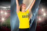 Excited football fan in brasil tshirt holding argentina flag