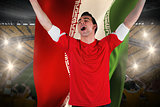 Excited football fan cheering holding iran flag