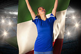 Cheering football fan in blue jersey holding italy flag