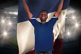 Cheering football fan in blue jersey holding france flag